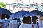 July 11, 2011 - Tokyo, Japan - Several women are seen holding fashionable parasols in downtown Tokyo. Japanese people, especially middle-aged women, use parasols during the hot Summer months to avoid any form of skin cancer. Today, parasols are also becoming popular among young adult women due to various designs and colors available on the market. (Photo by Yumeto Yamazaki/AFLO)