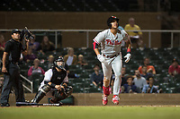Scottsdale Scorpions first baseman Darick Hall (30), of the Philadelphia Phillies organization, hits a home run in front of home plate umpire Nestor Ceja and catcher Daulton Varsho (8) during an Arizona Fall League game against the Salt River Rafters at Salt River Fields at Talking Stick on October 11, 2018 in Scottsdale, Arizona. Salt River defeated Scottsdale 7-6. (Zachary Lucy/Four Seam Images)
