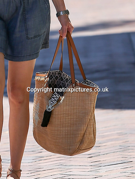 NON EXCLUSIVE PICTURE: MATRIXPICTURES.CO.UK<br /> PLEASE CREDIT ALL USES<br /> <br /> UK &amp; AUSTRALIAN RIGHTS ONLY<br /> <br /> American actress Elizabeth Banks is spotted during a shopping spree in Beverly Hills, California.<br /> <br /> The 42-year-old looks casual wearing a striped shirt paired with a blue skirt. <br /> <br /> JULY 21st 2016<br /> <br /> REF: MXP 162408<br /> <br /> WCN/ROSARIO