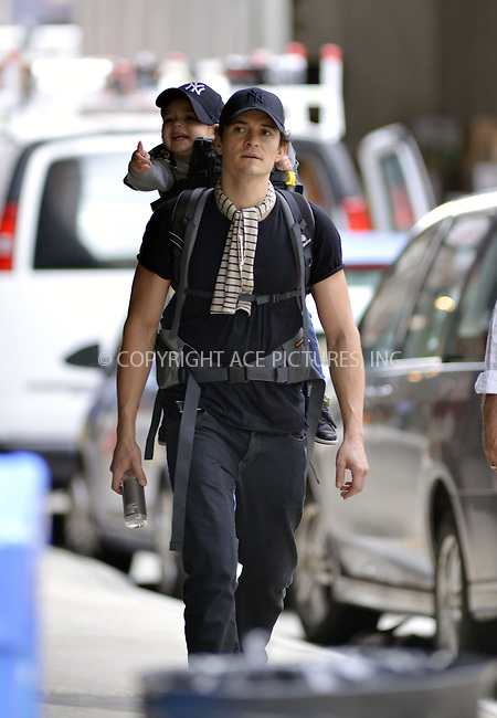 WWW.ACEPIXS.COM<br /> <br /> September 16 2013, New York City<br /> <br /> Actor Orlando Bloom walks in Tribeca with his son Flynn on September 16 2013 in New York City<br /> <br /> By Line: Curtis Means/ACE Pictures<br /> <br /> <br /> ACE Pictures, Inc.<br /> tel: 646 769 0430<br /> Email: info@acepixs.com<br /> www.acepixs.com