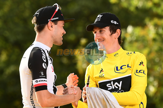 Overall winner Yellow Jersey Geraint Thomas (WAL) Team Sky and 2nd place Tom Dumoulin (NED) Team Sunweb congratulate one another on the podium at the end of Stage 21 of the 2018 Tour de France running 116km from Houilles to Paris Champs-Elysees, France. 29th July 2018. <br /> Picture: ASO/Alex Broadway | Cyclefile<br /> All photos usage must carry mandatory copyright credit (© Cyclefile | ASO/Alex Broadway)