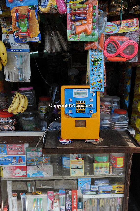 A public phone is placed on the counter at Variety shop in Madras, India
