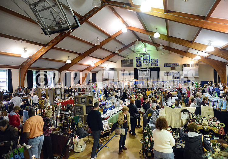 DOYLESTOWN, PA - NOVEMBER 1: Shoppers browse crafts for sale at the Our Lady of Mount Carmel Holiday Craft Fair  November 1, 2014 in Doylestown, Pennsylvania. Proceeds from this fundraising event will benefit Our Lady of Mount Carmel School. (Photo by William Thomas Cain/Cain Images)