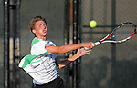 Forest Hills Central's Grant Veltman returns a forehand in the MHSAA regional tournament in Grand Rapids, Michigan on October 8, 2010.  (Photo by Bob Campbell)