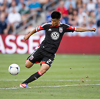 Long Tan (27) of D.C. United takes a shot at Livestrong Sporting Park in Kansas City, Kansas.  D.C. United lost to Sporting Kansas City, 1-0.