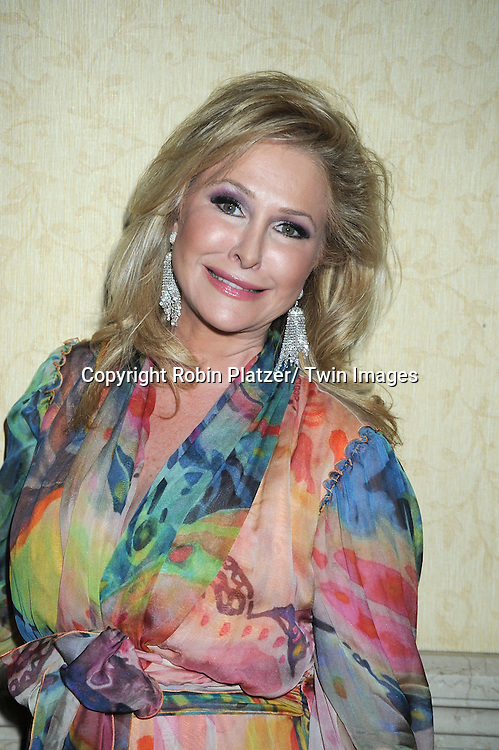 Kathy Hilton  in earrings by Liz Taylor attending the Oxygen Upfront on April 4, 2011 at Gotham Hall in New York City.