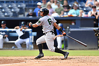 Augusta GreenJackets left fielder Ismael Munguia (6) swings at a pitch during a game against the Asheville Tourists at McCormick Field on August 19, 2018 in Asheville, North Carolina. The Tourists defeated the GreenJackets 6-3. (Tony Farlow/Four Seam Images)