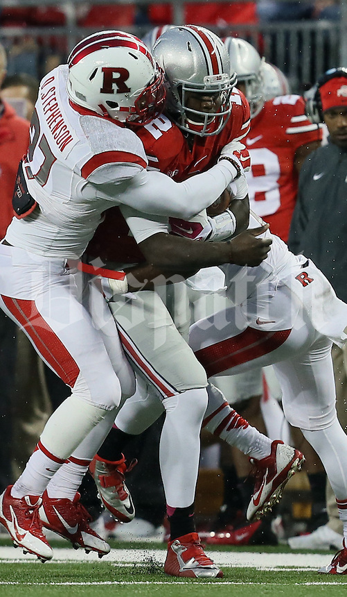 It takes four Rutgers players to tackle Ohio State Buckeyes quarterback Cardale Jones (12) in the fourth quarter of their game at Ohio Stadium in Columbus, Ohio on October 18, 2014. (Columbus Dispatch photo by Brooke LaValley)