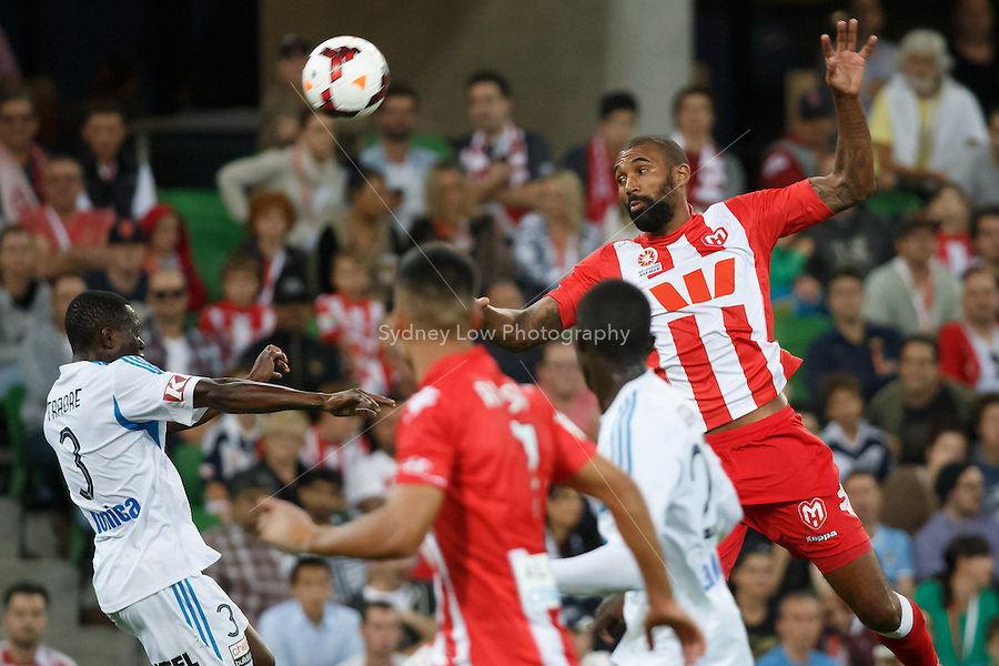 Adama TRAORE of the Victory and Orlando ENGELAAR of the Heart jump for the ball in the round 21 match between Melbourne Heart and Melbourne Victory in the Australian Hyundai A-League 2013-24 season at AAMI Park, Melbourne, Australia. Photo Sydney Low/Zumapress<br /> <br /> This image is not for sale on this web site. Please visit zumapress.com for licensing