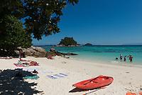 People sunbathing on small private beach of Serendipity hotel, Ko Lipe, Thailand