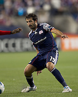 New England Revolution midfielder Monsef Zerka (19) defends. In a Major League Soccer (MLS) match, the New England Revolution defeated FC Dallas, 2-0, at Gillette Stadium on September 10, 2011.