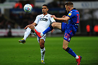 Kyle Naughton of Swansea City battles with Craig Noone of Bolton Wanderers  during the Sky Bet Championship match between Swansea City and Bolton Wanderers at the Liberty Stadium in Swansea, Wales, UK.  Saturday 02 March, 2019