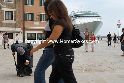 Venice Italy 2009. Cruise ship  passengers Rumanian gypsy woman begging