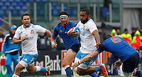Rugby, Torneo Sei Nazioni: Italia vs Francia. Roma, stadio Olimpico, 15 marzo 2015.<br /> Italy's Samuela Vunisa, second from right, is challenged by France's Loan Goujon, right, and Yoann Huget, during the Six Nations championship rugby match between Italy and France at Rome's Olympic stadium, 15 March 2015.<br /> UPDATE IMAGES PRESS/Riccardo De Luca