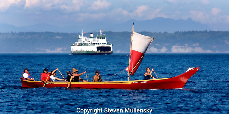 "Paddlers from Turtle Island in British Columbia paddle their canoe along Admiralty Inlet at the mouth of Port Townsend Bay in the State of Washington. The paddlers were on their way to join other tribes in the annual Puget Sound ""Traveling the traditional highways of our Ancestors"" paddle to Lummi Island."