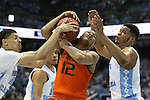 20 February 2016: Miami's James Palmer (12) is defended by North Carolina's Justin Jackson (left) and Kennedy Meeks (right). The University of North Carolina Tar Heels hosted the University of Miami Hurricanes at the Dean E. Smith Center in Chapel Hill, North Carolina in a 2015-16 NCAA Division I Men's Basketball game. UNC won the game 96-71.