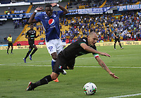 BOGOTÁ- COLOMBIA,21-07-2019:Fabian Gonzalez Lasso (Izq.) jugador de Millonarios disputa el balón con Andres Correa (Der.) jugador del Once Caldas durante partido por la fecha 2 de la Liga Águila II 2019 jugado en el estadio Nemesio Camacho El Campín de la ciudad de Bogotá. /Fabian Gonzalez Lasso (L) player of Millonarios fights the ball  against of Andres Correa(R) player of Once Caldas during the  match for the date 2 of the Liga Aguila II 2019 played at the Nemesio Camacho El Campin stadium in Bogota city. Photo: VizzorImage / Felipe Caicedo / Staff