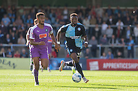 Gozie Ugwu of Wycombe Wanderers  chases down the ball under pressure from Curtis Nelson of Plymouth Argyle during the Sky Bet League 2 match between Wycombe Wanderers and Plymouth Argyle at Adams Park, High Wycombe, England on 12 September 2015. Photo by Andy Rowland.