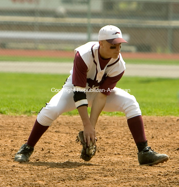 NAUGATUCK, CT- 10 MAY 2008 --051008JS03- Naugatuck's Xavier Ortiz (21) feilds a ground ball during their 3-2 loss to Crosby Saturday at Naugatuck High School. <br /> Jim Shannon / Republican-American