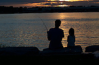 Jason Mears, of Sarnia and his three-year-old daughter Miah Mears fish the sunset away at Guthrie Park . Jason hooked into a large sheep head which he landed and release back into the St. Clair River.