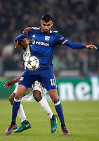 Calcio, Champions League: Gruppo H, Juventus vs Lione. Torino, Juventus Stadium, 2 novembre 2016. <br /> Juventus&rsquo; Patrice Evra, left, and Lyon's Rachid Ghezzal fight for the ball during the Champions League Group H football match between Juventus and Lyon at Turin's Juventus Stadium, 2 November 2016. The game ended 1-1.<br /> UPDATE IMAGES PRESS/Isabella Bonotto