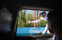 "Fabian Cancellara (SUI/Trek-Segafredo) checks in at the team car during the recon of the prologue telling his mechanic Roger Teel ""It will be like riding into an arena this afternoon."" <br /> <br /> stage 1: Apeldoorn prologue 9.8km<br /> 99th Giro d'Italia 2016"