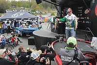 NWA Democrat-Gazette/FLIP PUTTHOFF <br /> Scott Canterbury of Springville, Ala., shows two of his five bass Friday April 15, 2016 at the Walmart FLW Tour weigh-in at Prairie Creek park. Canterbury is in second place among pro division anglers. The top 20 pros fish in the semi-finals today. Weigh-in is at 4 p.m. at the Rogers Walmart store on West Walnut Street.