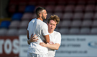 Mickey Fisher (Actor) celebrates a goal with Taser Hassan during the 'Greatest Show on Turf' Celebrity Event - Once in a Blue Moon Events at the London Borough of Barking and Dagenham Stadium, London, England on 8 May 2016. Photo by Andy Rowland.