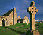 County Offaly, Ireland<br /> Cross of the Scriptures, an 9th century High Cross, stands before the ancient walls of the Clonmacnoise monastery and the Temple Dowling
