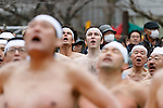 Participants dressed only in loincloths  warm themselves up before to enter in a pool of freezing-cold water containing two large blocks of ice during the 62nd Annual Cold-Endurance Festival, Kanchu-Misogi, at Teppozu Inari Shrine on January 8, 2017, Tokyo, Japan. About 100 brave participants joined the purification ritual to pray for a healthy new year. (Photo by Rodrigo Reyes Marin/AFLO)