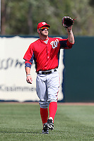 Washington Nationals right fielder Bryce Harper #34 warms up in between innings of a spring training game against the Houston Astros at Osceola County Stadium on March 3, 2012 in Kissimmee, Florida.  (Mike Janes/Four Seam Images)