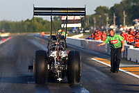 Aug. 16, 2013; Brainerd, MN, USA: Crew members for NHRA top fuel dragster driver Terry McMillen during qualifying for the Lucas Oil Nationals at Brainerd International Raceway. Mandatory Credit: Mark J. Rebilas-
