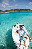 EXUMA, Bahamas. Grant, one of the managers at the Fowl Cay Resort taking the resort speedboat for a ride.