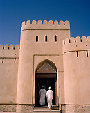 OMAN, Nizwa, men walking on steps to the entrance of a souq.