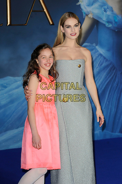 LONDON, ENGLAND - MARCH 19: Eloise Webb and Lily James attending the 'Cinderella' UK Premiere at Odeon Cinema, Leicester Square on March 19, 2015 in London, England<br /> CAP/MAR<br /> &copy; Martin Harris/Capital Pictures