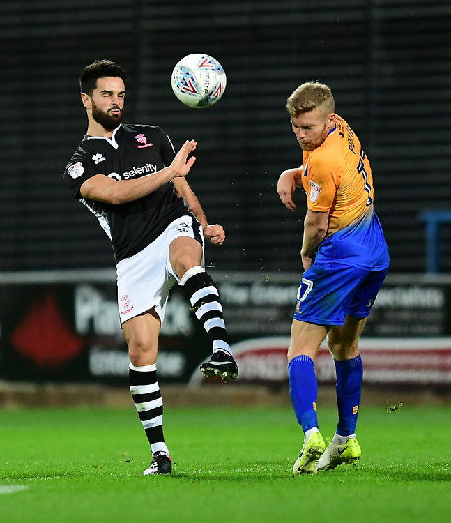 Lincoln City's Sam Habergham vies for possession with Mansfield Town's Alfie Potter<br /> <br /> Photographer Chris Vaughan/CameraSport<br /> <br /> The EFL Checkatrade Trophy - Mansfield Town v Lincoln City - Tuesday 29th August 2017 - Field Mill - Mansfield<br />  <br /> World Copyright &copy; 2018 CameraSport. All rights reserved. 43 Linden Ave. Countesthorpe. Leicester. England. LE8 5PG - Tel: +44 (0) 116 277 4147 - admin@camerasport.com - www.camerasport.com