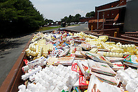 A huge container of spoiled food, a product of a massive power outage in Central Virginia, stands in the hot sun behind the Food Lion supermarket in Charlottesville, VA. High winds from last Friday's storm downed numerous trees and caused massive power outages across the area.