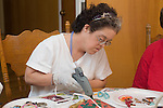 Concord CA, Intellectually handicapped adult working on mask-making project at her residential home  MR