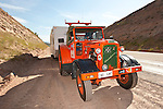 1960s Chamberlain Champion 9G tractors from Australia pull travel trailers on their US sojourn up Deep Creek Canyon on U.S. Highway 40 in Utah