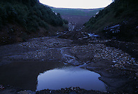 A valley fill begins to fail after a summer rainstorm causing flooding to homes downstream.<br /> A much as 500 feet or more of a mountain summit may be leveled. The earth and rock from the mountaintop is then dumped in the neighboring valleys. Over 1,000 miles of streambeds are buried equaling the entire length of the Ohio River.