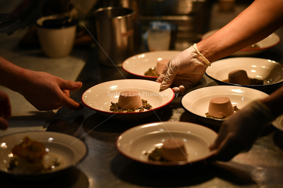 MELBOURNE, 30 June 2017 – A dish of Chicken liver royale, Le Puy green lentils & black truffle by Sasha Randle being prepared at a dinner celebrating Philippe Mouchel's 25 years in Australia with six chefs who worked with him in the past at Philippe Restaurant in Melbourne, Australia.