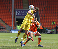 Fleetwood Town's Ched Evans and Blackpool's Curtis Tilt<br /> <br /> Photographer Stephen White/CameraSport<br /> <br /> The EFL Sky Bet League One - Blackpool v Fleetwood Town - Monday 22nd April 2019 - Bloomfield Road - Blackpool<br /> <br /> World Copyright © 2019 CameraSport. All rights reserved. 43 Linden Ave. Countesthorpe. Leicester. England. LE8 5PG - Tel: +44 (0) 116 277 4147 - admin@camerasport.com - www.camerasport.com