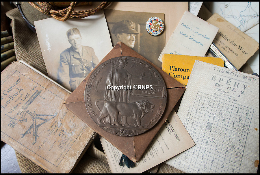 BNPS.co.uk (01202 558833)<br /> Pic: PhilYeomans/BNPS<br /> <br /> Various emphemera from the trenches and the bronze 'Death plaque' sent to his greiving family.<br /> <br /> Poignant time capsule trunk from the Great War rediscovered...<br /> <br /> An incredible 'time capsule' trunk containing the personal effects of a tragic World War One officer that his grieving family shut away in 1918 has been unearthed - almost 100 years later.<br /> <br /> The military items belonged to Second Lieutenant Charles Bodman, from Marshfield, Glos, who was killed three months before the end of the war in 1918.<br /> <br /> After his death all his possessions, including his uniforms, caps, brass badges, detailed trench maps, orders, handbooks, photographs, German souveniers, letters, water bottles, lanyard and even spent bullets, were sent back to his widowed mother Sarah who locked them away in the trunk.