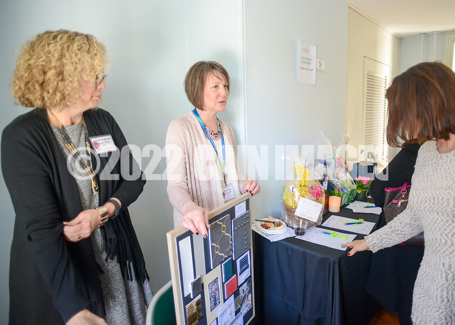 From left, designers Ceil Di Gugliamo and Josie Kriley of Domani Design speak with guests at the Bucks County Designer House Empty House Party Sunday, February 26, 2017 in Buckingham, Pennsylvania. (Photo by William Thomas Cain)