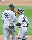 Baltimore, MD - April 6, 2009 -- New York Yankee pitcher C.C. Sabithia (52) discusses first inning strategy with catcher Jorge Posada (20) on Opening Day against the Baltimore Orioles at Oriole Park at Camden Yards in Baltimore, MD on Monday, April 6, 2009..Credit: Ron Sachs / CNP.(RESTRICTION: NO New York or New Jersey Newspapers or newspapers within a 75 mile radius of New York City)