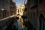 Buildings and blue sky reflected in a Venitia Canal,  Venice Italy