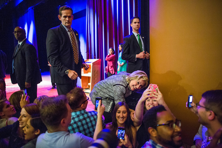 Former Secretary of State Hillary Clinton takes a selfie with a supporter after speaking about her new book, 'Hard Choices: A Memoir,' at George Washington University  in Washington, DC.  Clinton is on a nationwide tour to promote the new memoir with a book signings, speeches & media interviews.   She is not expected to decide on whether to run for President before the end of the year.