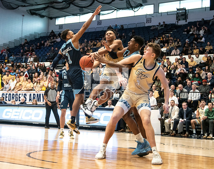 WASHINGTON, DC - FEBRUARY 8: Jameer Nelson Jr. #12 and Chase Paar #3 of George Washington clash with Antwan Walker #5 of Rhode Island under the basket during a game between Rhode Island and George Washington at Charles E Smith Center on February 8, 2020 in Washington, DC.