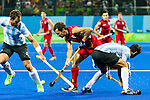 Juan Gilardi #4 of Argentina tackles during Argentina vs Belgium  in the men's gold medal game at the Rio 2016 Olympics at the Olympic Hockey Centre in Rio de Janeiro, Brazil.