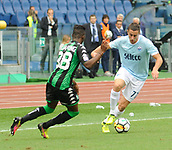 1st October 2017, Stadio Olimpico, Rome, Italy; Serie A football, Lazio versus Sassuolo; Marusic in action as he takes on the challenge from Claud Adjapong